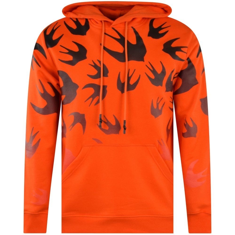orange men's hoodie with black swallow pattern from MCQ