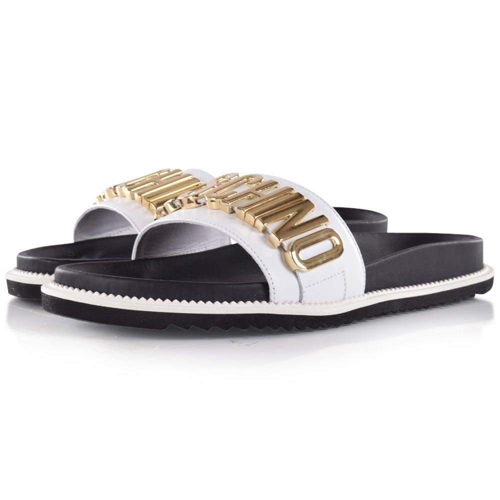 3872ec175137e MOSCHINO FOOTWEAR Moschino White   Gold Letter Sliders - Men from  Brother2Brother UK