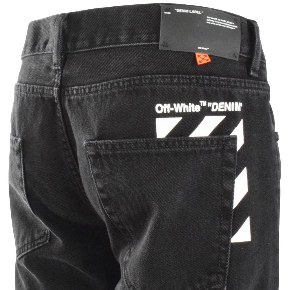 rear of black jeans with white Off-White logo details